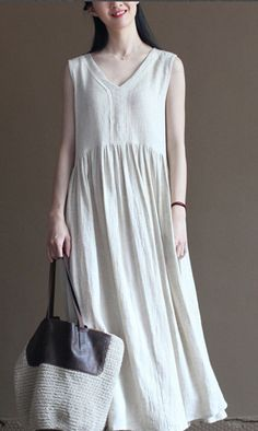 A casual style white linen sundress. Perfect for holiday. Stay away from the job and city life. White flowy linen dress summer long maxi dress sundresses beach holiday dress