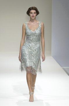 143 photos of Collette Dinnigan at Paris Fashion Week Spring 2004.