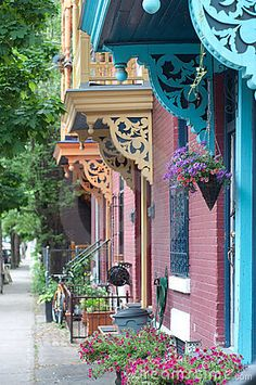 City doorways with corbels by Limestudios, via Dreamstime Victorian Porch, Victorian Homes, Fung Shui Home, Moldings And Trim, Moulding, Creole Cottage, Wooden Corbels, Porch And Balcony, Coastal Farmhouse