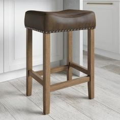 Nathan James Hylie 24 in. Dark Gray PU Leather Nailhead Saddle Cushion Light Brown Wood Pub-Height Counter Bar Stool 21307 - The Home Depot Counter Stools With Backs, Metal Counter Stools, Bar Counter, Backless Counter Stools, Contemporary Kitchen Counters, Brown Wood, Dark Brown, Dark Walnut, Walnut Wood