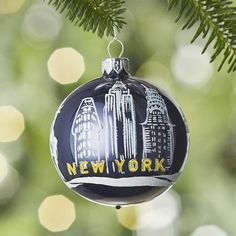 The Chrysler, Empire State and Flatiron buildings join the Statue of Liberty in marking out the famous New York skyline, hand painted on a dark blue ball ornament. Each handcrafted glass ornament is made in Poland at a factory renowned for its mastery of traditional, Old World techniques. Choose your home town or document your travels with our exclusive collection of seven city-themed ball ornaments.