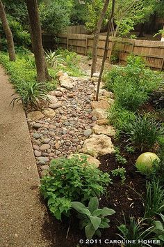 How to Install a Dry Creek Bed: beautiful way to control drainage in landscaping