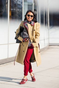 Margaret Zhang color-coordinates her trousers to her trainers (and her turtleneck to her lining!). New Balance 574 Classic Trainers, $116.04, available at Van Mildert; alice + olivia Arthur Pant, $264, available at alice + olivia.