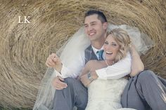 Hay bale as backdrop for wedding photography. Southern Illinois wedding portraits. Photo by Little Keepsakes Photography. http://www.facebook.com/lkphoto85