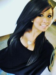 Black hair and ombré tips. Hair length with long layers and bangs