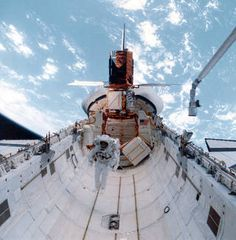 The Solar Maximum Mission spacecraft berthed to the Space Shuttle cargo bay