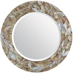 Natural shell nacre forms a glittering mosaic pattern on this dazzling handcrafted, mother-of-pearl mirror