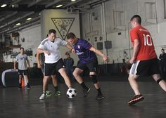 PACIFIC OCEAN (June 22, 2014) Sailors play soccer in the hangar bay on board the aircraft carrier USS Nimitz (CVN 68). Nimitz is currently underway performing routine operations and training exercises. (U.S. Navy photo by Mass Communication Specialist Seaman Eli K. Buguey/Released)