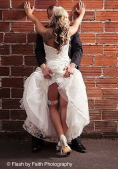 We like women who go after what they want! And what a fun and flirty way to get that garter shot!