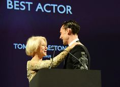 Tom Hiddleston accepts the Best Actor award for 'Coriolanus' at the 60th London Evening Standard Theatre Awards at the London Palladium on November 30, 2014