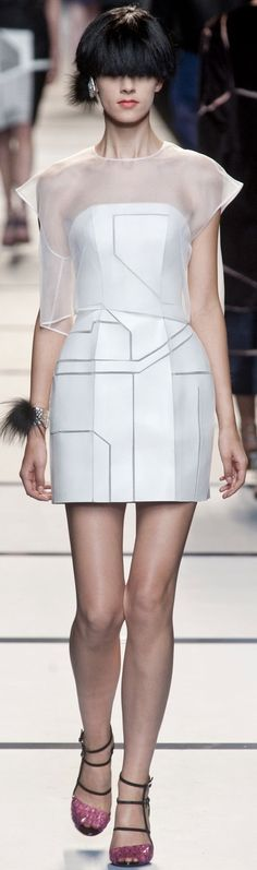 In this Karl Lagerfeld design, the top and bottom parts of the dress follow similar shape, with the goal of making the body look like a ruler by making the dress tubular . This dress follows the element of shape.