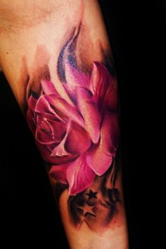 arm tattoo with rose