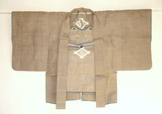 This is a samurai's hanten ( jacket ) and maetate ( apron ) which are worn in case of fire. It is made of handwoven asa ( hemp ) cloth. In good condition except for some tiny moth holes in the back. Edo period.