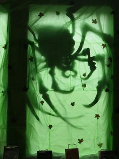 """Halloween 2014 double sided window display featuring scary, spooky, supernatural chapter books. Located in our Children's area. Display by Cristal Splitter. Spider Silhouette design by """"DAVE LOWE DESIGN""""."""