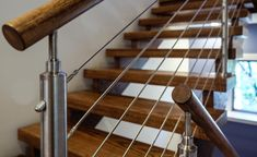Our cable railing systems give your stairs a distinct modern touch. Expertly installed, they lend a unique beauty to your stairs. Iron Balcony, Balcony Railing, Wood Handrail, Railings, Stainless Steel Staircase, Types Of Stairs, Cable Railing Systems, Stone Accent Walls, Stair Railing Design