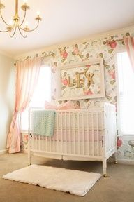 beautiful baby girl nursery with floral wallpaper  jenny lind crib.