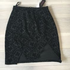Black velvet printed mini skirt! Super cute! Never worn and still has tags! Mini skirt with a velvet black on black print. Zipper in back. High waisted fit. Two uneven slits in the front. Trendy, cute with black tight too for going out. From LF stores. Runs on the smaller side. LF Skirts Mini