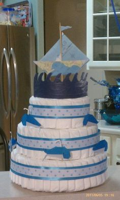 Nautical theme diaper cake for a friend's baby shower. Origami whales and an origami sail boat made out of a map.