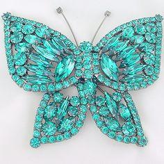 Rhinestone butterfly brooch.