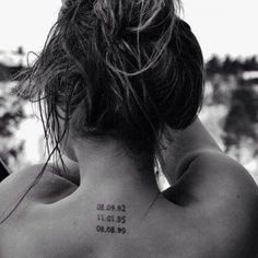 Little tattoo of three dates on the back.
