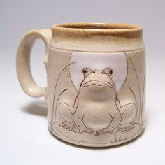 this is the most adorable frog.  he looks so content and happy.  he'd cheer up my morning coffee break.  Bull Frog Pottery Coffee Mug left hand view  Limited by JimAndGina, $22.00