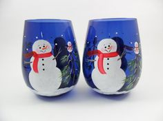 These stemless wine glasses in beautiful cobalt blue have two snowmen hand painted on each glass. They are wearing red scarves and there is a snow baby atop the snow covered trees. Great hostess gift or gift basket idea. All of my glassware is hand painted using non toxic enamel paints. Hand washing is recommended. **BACK TO PAINTING BY ELAINES HOMEPAGE** http://www.paintingbyelaine.etsy.com