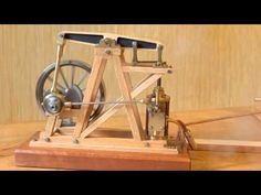 Here is another view of my version of Gerrys beam engine with a wooden frame. I usually run my engines on compressed air but it's nice to run them on steam o. Woodworking Techniques, Woodworking Jigs, Woodworking Projects, Miniature Steam Engine, Mechanical Engineering Projects, Pin Up Posters, Mechanical Design, Metal Projects, Wood Toys