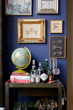 Transform your bar cart nook with a fresh coat of paint a a gallery wall of vintage frames. (Paint color: @DutchBoyPaint in Wish Upon a Star!)