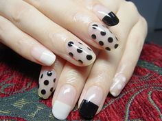 Black and white dipped, dots and negative space nails