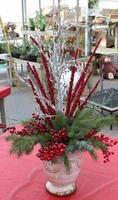 Silk winter arrangement with a touch of fresh greens
