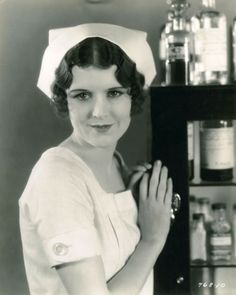 "June Collyer and her nifty medicine cabinet in ""The Love Doctor"" (1929)"