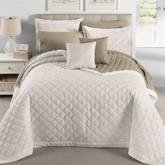 I like this as a base spread. It could give the look of the expensive one and would look nice with a plaid throw to go with it. Simon has the same one in a different color and it's nice and lightweight.