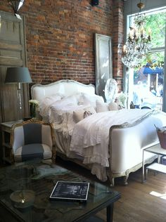 LOVE the gray & gold chair...and the cozy bed & chandie :-) I'd really like that chair for my bedroom