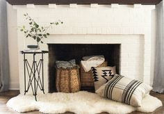 If your home has one of those pesky faux fireplaces, we've got ideas for you on sprucing and cozying it up for fall!