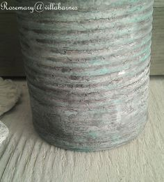 Tin Can Transformation - this post shows how layers of glue and gesso were added to this tin can to show how easy this layered, crackled paint finish is to do.