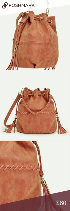 Fill Rust Colored Bag Materisl is faux leather,   9L?9H?5D Gold hardware  I interior pocket, and 1 interior zip Pull closure,  and a beautiful rust color. This is brand new, and stll wrapped in packing detail. Just Fab Bags Shoulder Bags
