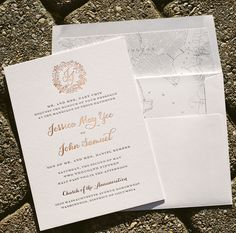 Jessica and John created these custom rose gold wedding invitations with fonts and motifs from our library, adding a custom duogram and a vintage map liner.