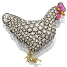Ruby, enamel, and diamond hen brooch by Michele Della Valle.