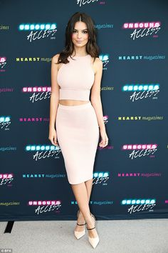 Emily Ratajkowski celebrated her recent Cosmo cover in a pale pink two piece ensemble http://dailym.ai/1wldGVO