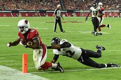 GLENDALE, AZ - OCTOBER 26: Wide receiver John Brown #12 of the Arizona Cardinals scores a touchdown against the cornerback Jimmy Smith #22 of the Baltimore Ravens in the fourth quarter of the NFL game at University of Phoenix Stadium on October 26, 2015 in Glendale, Arizona.  (Photo by Norm Hall/Getty Images)