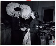 A WAVE Specialist takes over for an enlisted man at the Mail Division of the Navy Department at Washington, D. C. in March 1944. US Navy Official photograph, Gift of Charles Ives, from The Digital Collections of the National WWII Museum, 2011.102.170.