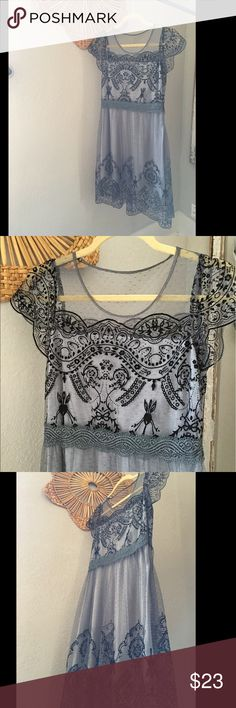 Blue Lace Slip Dress Worn once! This is a great lace/ slip style dress that is trending right now! Something similar to what you can find at Anthropologie or For Love and For Lemons. Navy color but is offset by the lighter slip under. Listed as size small but I would say it would fit a 2 best. I am a size 4 and it is tight on my chest Anthropologie Dresses Midi