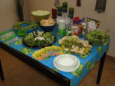 Love the food at this frog themed shower- this is now my go-to plan.  Green veggies and fruits and the green punch.  I would also add dips (hummus?, ranch, onion?, spinach/bread to dip?), chicken salad, 3bean salad, crackers and cupcakes (lemon lime! maybe with frogs on top).  Maybe some green candy also.  Also love the idea of a reusable frog blanket for a table cloth.