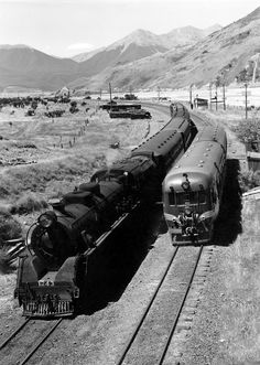 Train time at Cora Lynn. An Arthur's Pass bound passenger train headed by mountain-type steam loco Ja 1243 crosses a Fiat railcar bound for ...