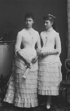 Princesses Irene and Alix of Hesse and by Rhine dressed as bridesmaids on the occasion of Princess Beatrice's wedding, 1885, photo by Gustav William Henry Mullins