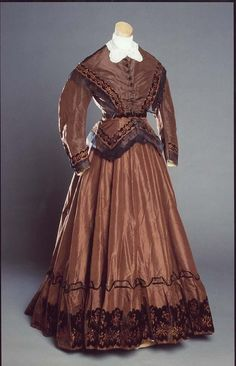 1858  Dark brown taffeta dress - includes 2 other bodices, 2 capelets and extra fabric Worn at Cool Springs Plantation in North Carolina NCDCR