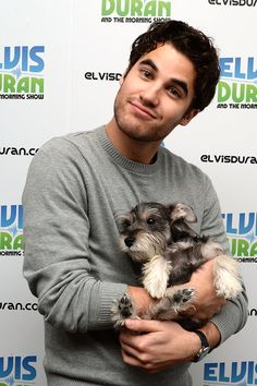 It's hard to say which is cuter: the guy or the dog. See 34 hot guys holding puppies, including Darren Criss, and be the judge.<< Darren Criss for the win (though Ian and his dog were kind of cute together)
