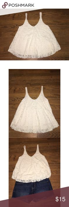 American Eagle Flowy Lace Tank XS Size XS. All-over lace tank with lining. Super cute, flowy style and pretty cream color. GUC! No holes, stains or tears! American Eagle Outfitters Tops Tank Tops