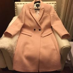 GORGEOUS !!! Pale pink top coat Stunning tailored Banana Republic top coat it has a beautiful white pin stripe lining and black buttons. This beauty is a petite small and fits like a regular medium . It's wool poly and nylon. A fabulous addition to any wardrobe . This coat is perfect for fall . Banana Republic Jackets & Coats Trench Coats