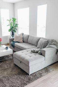 """""""By day our stylish and comfortable sofa bed is where we enjoy watching TV or a movie. It's where friends and family can lounge and relax when they come to visit us."""" Photo by Color and Chic."""